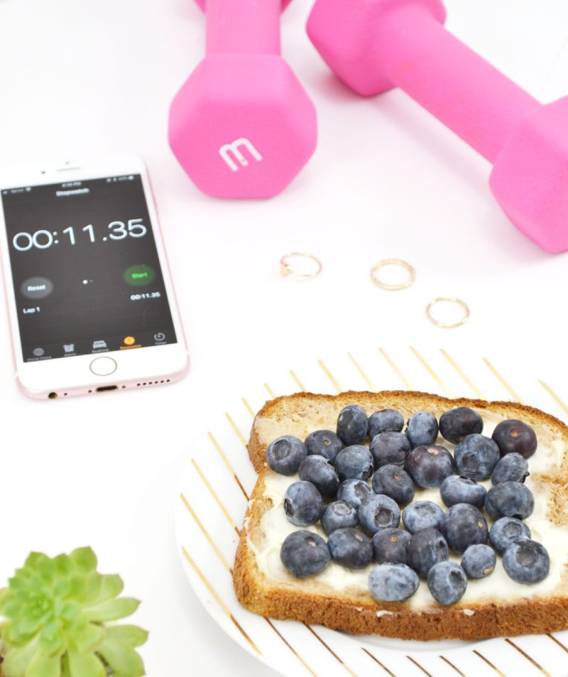 blueberries on a piece of bread and dumbbells